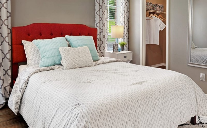 bedroom with easy access to a closet and with ample space around bed area