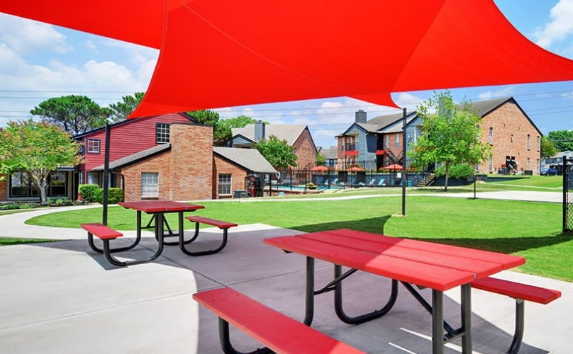 outside seating areas with umbrellas and open, spacious room
